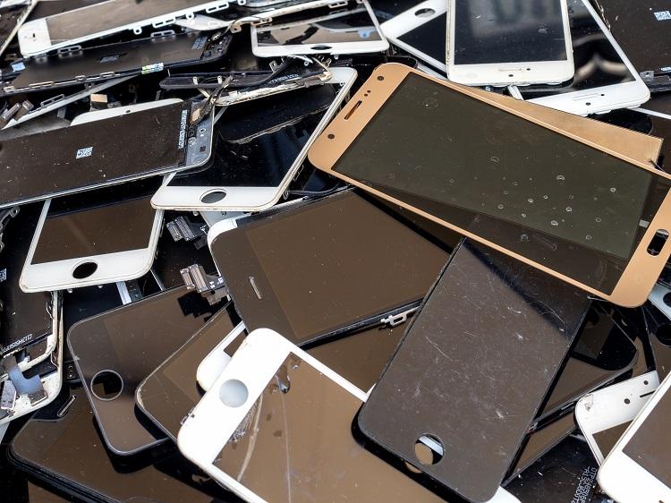 heap of broken smartphone screen (e-waste, electronic-waste)