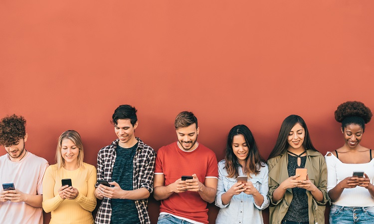 Group young people using mobile smartphone outdoor - Millennial generation having fun with new trends social media apps - Youth technology addicted - Red background