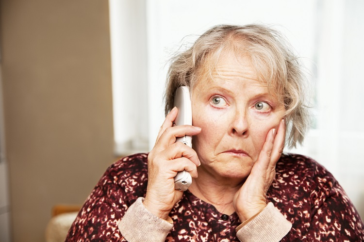 senior woman, 58 years old, doing a phone call with worries expression